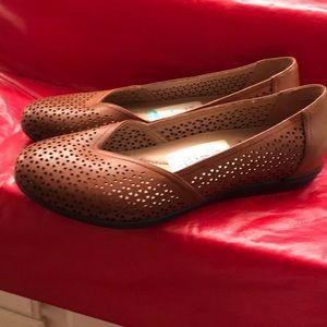 Dansko brand new pair of Brown Flats